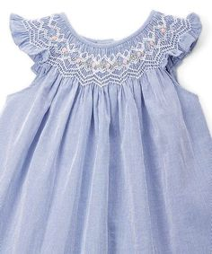 Deck your little out in classic style with this dress featuring angel sleeves and an oh-so sweet smocked neckline.