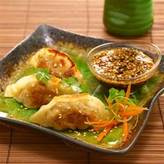 crispy pork and shiitake mushroom dumplings with toasted sesame dipping sauce by chef christopher lee Pork Recipes, Asian Recipes, Cooking Recipes, Oriental Recipes, Sauce Recipes, Yummy Recipes, Yummy Food, Dumplings, Arrows