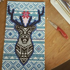 Had to cut out a white bead and iron in a blue...worked out great! The deer is copied from a image here at pinterest. The pattern around is knit inspired...Marius pattern.