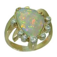 Opal Ring with 1/3 cttw. Diamonds https://www.goldinart.com/shop/colored-gemstone-rings/opal-ring-13-cttw-diamonds