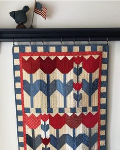 """116 Likes, 7 Comments - karen walker (@laughyourselfintostitches) on Instagram: """"Why not hang tulips in July? Marcia's completed version of my #tulipcrushquilt pattern i❤️it!! """""""