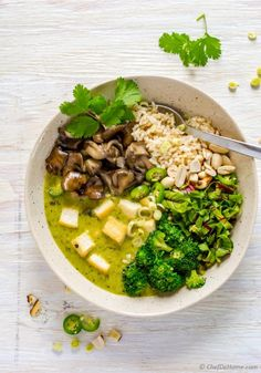 Easy and flavorful Thai Green Curry dinner made with fresh homemade green curry paste and coconut curry sauce tossed with sauted broccoli, meaty maitake mushrooms, crispy tofu, and brown rice. This...