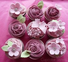Beautiful....this website has great ideas for decorating your cupcakes.