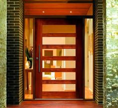 Glass pivot doors are the perfect solution to let in lots of natural light! Glass pivot doors are the perfect solution to let in lots of natural light! Check out our selection of glass-paned p Modern Exterior Doors, Modern Front Door, Modern Entryway, Modern Garage, Front Door Entrance, House Entrance, Entry Doors, Front Doors, Front Door Handles