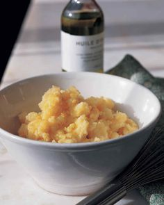 Garlic cloves add pungent complexity to creamy mashed potatoes.