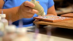 Handpainting decorative Cuerda Secas.  Check out our Tile Terminology on the blog!