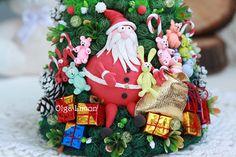 Big original handmade Christmas tree with toys and Santa Claus