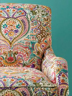 Love the colors -  Paisley color galore love to redo my upholstered granny chair in this.