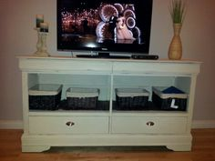 Upcycled dresser. Took two rows of drawers out, put a shelf in, changed hardware and created my own chalk paint and destressed it.