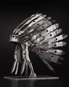 (Sold)(Lawn Mower) Blade Bonnet, a Metal on Steel by Peter McFarlane from Canada. It portrays: Political, relevant to: head dress, recycled, sculpture, steel, used materials, war bonnet, ceremonial, first nation, conceptual, feathers, Sioux, native It is part of a series of First Nation masks and headresses I created out of used objects (chainsaws, shovels, rototiller blades etc.) that transformed nature.  The obvious metaphor being an attempt to clear-cut nature and culture.