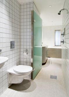 Clever solution in long narrow bath . Just divide the room with fold in shower doors.