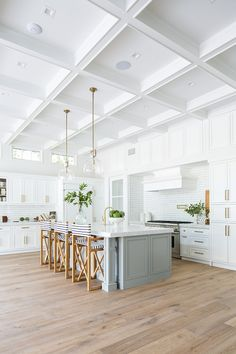 Coastal Farmhouse White Kitchen with light grey island and boxed beamed coffered ceiling Coastal Farmhouse White Kitchen Coastal Farmhouse White Kitchen #CoastalFarmhouse #CoastalFarmhousekitchen #WhiteKitchen #lightgreyisland