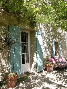 Shady patio, robin's egg blue shutters, perfectly distressed walls, French farmhouse perfection. Photograph A farmhouse in Provence by Leo B. on 500px