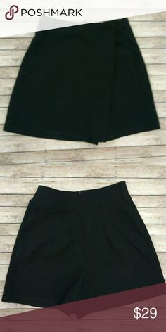 """Vintage Black High Waist Skort Fun and 90's era Skort. That means skirt in the front and short in the back. I know , I know... But this one screams cute, innocent but yet grunge and hip. Brand is called """" All that Jazz"""" . Size tag states size 5/6 so about a small. Buttons intact etc . Great used Vintage condition. Made in USA. Approx measurements 12.5 in. waist, 17-1/4 in. hips, and 16-3/4 in. length. 100% Polyester. Vintage Skirts"""