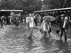1976: A punter finishes off his champagne despite the flooding. Picture: Herald Sun Image Library Source: HeraldS