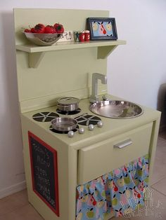 Turn an old nightstand into a play kitchen!!! Great thrift store upcycle idea!   Mom was just saying that she was going to start a business making these for cheap the other day.