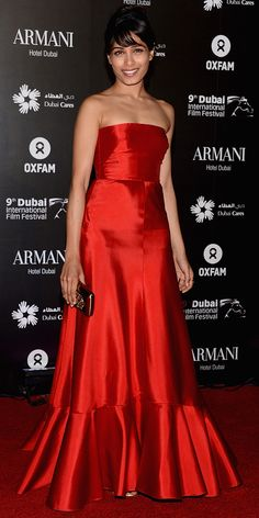 Freida Pinto in vintage Valentino - I love how the red is on the burnt orange spectrum. Gorgeous with her skin tone!