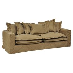 Abounding with an array of cotton velvet cushions and throw pillows, this cool brown sofa makes a breezy statement in your living room.    ...