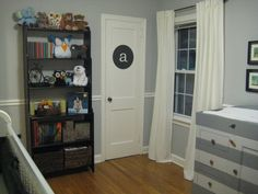 loving this grey nursery with black accents. cute changing table!