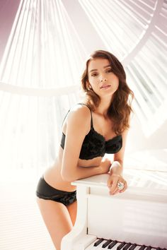 Mae in a classic black colourway offers pure indulgence with intricate floral flocking, lace trims and satin bows. Pure elegance and sophistication at its best.