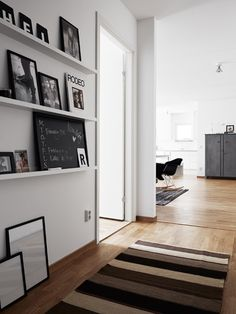 The Design Chaser: Minimalist Styling | Pella Hedeby. like the built in shelves for art work etc