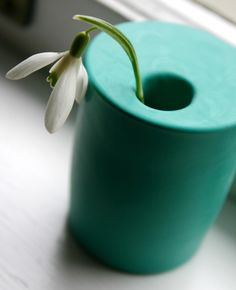 """This modern, ceramic-looking vase can be made in well under 30 seconds and only requires two materials: a 2"""" glass votive holder and a BALLOON. Crazy, right?? I love that you can make it in just about any color, not to mention the fact that it has the appearance of matte glazed porcelain (my fave)."""