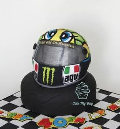 A very special cake for a 40th birthday celebration. He is a huge fan of MotoGP and Valentino Rossi, so here it is – Rossi's hand painted helmet cake :) My first try to hand paint such big part of the cake but the client LOVED it :)