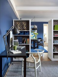 To give the open space just off the entry a purpose, yet keep the center of the area open for traffic flow in and out of the apartment, two pairs of ready-made bookshelves purchased from an office supply store were placed back-to-back to act as room dividers.