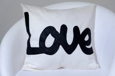 Decorative pillow case with the word word love by ThePillowWorld