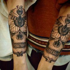 Man arm tattoo - skull and butterfly tattoo