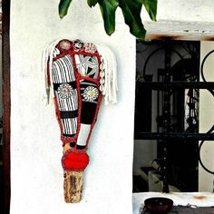A contemporary take on a tribal totem. Hand-painted South African textiles upholstered on a palm frond. It makes a quirky one off wall hanging which is a definite conversation piece. African Textiles, African Fabric, Wood Fish, Quirky Decor, Cute Penguins, African Masks, Ostrich Feathers, African Jewelry, Craft Stores