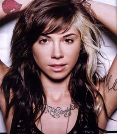 Embrace the gray: going to dye this type of front streak gray in my hair. Christina Perri with streaked hair on her left side.