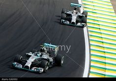 Sao Paulo, Brazil. 09th Nov, 2014. Motorsports: FIA Formula One World Championship 2014, Grand Prix of Brazil, #6 Nico Rosberg (GER, Mercedes AMG Petronas F1 Team), #44 Lewis Hamilton (GBR, Mercedes AMG Petronas F1 Team), © dpa picture alliance/Alamy Live News