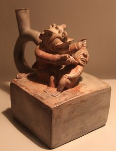 Moche sculptural stirrup spout bottle: Decapitator God Mochica culture.1AD-800AD Apogee epoch Museo Larco-Lima