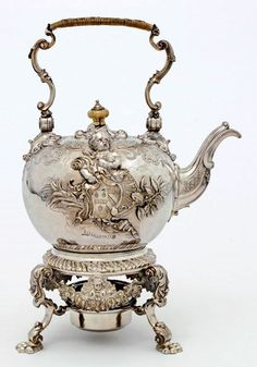Tea time was an important aspect to every day in the 18th century...so it would be only fitting to have a 'sitting/tea' area in my living room! 18th century rococo style tea set with matching burner and stand.  1stdibs.com
