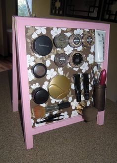 Magnetic makeup board!   I bought a chalkboard easel from ebay and painted it. I bought a 12x12 steel sheet from Home Depot and cut it to fit using a tin snip. Cut scrapbook paper to fit the steel sheet and used spray adhesive to glue it. Then hot glued magnets to my makeup!