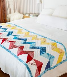 Love the colors.  Probably make a larger version.  OPAL™ Multi-Color Quilt - HUSQVARNA VIKING®