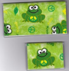 """Happy Peace Sign Frog Green Checkbook Cover Set by Tickled Pink Boutique. $9.50. Fun and functional for every day use without paying a designer price for a designer name!  The sturdy clear PLASTIC 12 gauge lightweight VINYL COVER encases a fabric bonded design. Measuring 6 1/4"""" x 3 1/4"""",  the checkbook cover fits all standard bank checkbooks and banking registers.  All checkbook covers come with a register flap and a duplicate check flap just like the bank.    The ..."""
