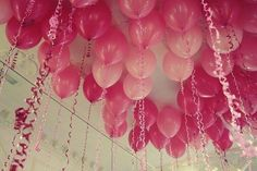 Balloons...  I do this all the time for my kids parties the ribbons hanging down create an awesome feeling.  I also blow up a bunch of loose reg air balloons to scatter across the floor too.