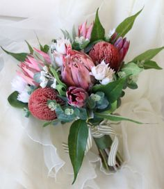 A rustic native protea bouquet, featuring Australian and South African native protea flowers, banksi Bouquet De Protea, Protea Flower, Silk Flower Bouquets, Flower Bouquet Wedding, Bridesmaid Bouquet, Silk Flowers, Bridesmaid Dresses, Wedding Bouquets, Party
