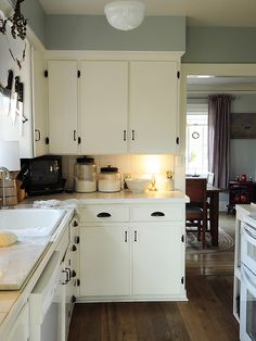 We are brainstorming for a DIY kitchen update: I am starting to really dig the white cabinets with a light accent color above....