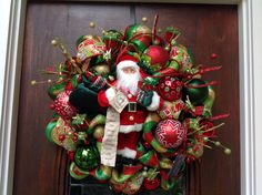 Traditional Santa With His Nice List by HertasWreaths on Etsy