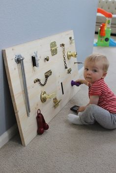 Other people added a rod with things to slide, a mirror, keys, and the child's name (the letters may also slide) - anything interactive!  Definitely screw this into the wall and maybe even seal it to avoid splinters.