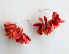 A pair of Blue Hydrangea Petals earrings made of artificial silk flowers. You can easily make them part of your daily fashion, adding the feeling