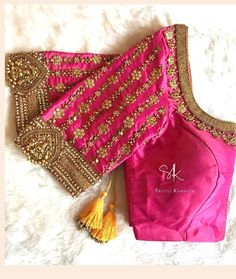Stunning pink color designer blouse with floral design hand embroidery gold trhe… Atemberaubende Designerbluse in rosa Farbe mit goldfarbenem Trhead und Zardosi-Stickerei. Wedding Saree Blouse Designs, Pattu Saree Blouse Designs, Half Saree Designs, Designer Blouse Patterns, Fancy Blouse Designs, Pink Saree Blouse, Maggam Work Designs, Stylish Blouse Design, Sleeve Designs