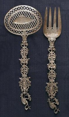 Origin:  Netherlands  Year:  1895 - 1905    A Dutch openwork handled silver fish scoop and fork set, circa 1900.