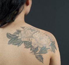 Floral shoulder tattoo.
