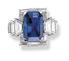 A SAPPHIRE AND DIAMOND RING, BY OSCAR HEYMAN BROTHERS   Set with a rectangular-cut sapphire weighing 13.30 carats, within a baguette-cut diamond frame, to the trapezoid and rectangular-cut diamond shoulders, mounted in platinum  With jeweller's mark for Oscar Heyman & Brothers. Art Deco or Art Deco style.