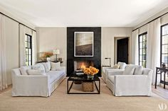 A blackened-steel fireplace anchors a serene Hamptons living room