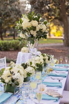 Breathtaking white and green wedding reception centerpiece; Featured Photographer: Traci Burke Photography and Cinema